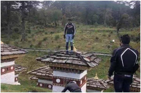 indian tourist detained in bhutan for climbing atop chorten