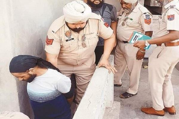 nri was taking drugs in the presence of shri guru granth sahib arrested