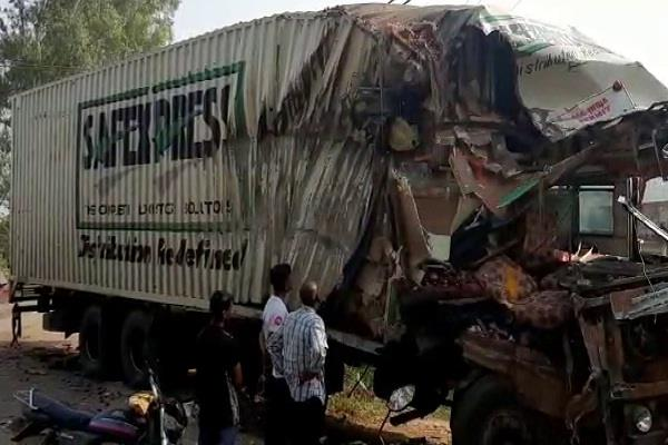 one killed three injured in collision between container and truck