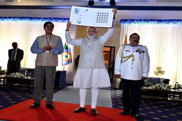 pm issues commemorative postage stamp on air force marshal arjan singh