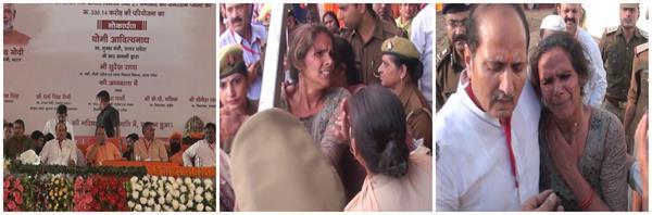 uproar in cm s public meeting policemen push women