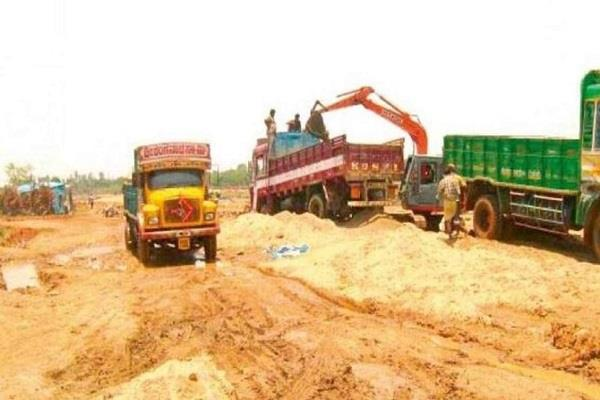major action police illegal sand mining 4 trucks a pokalane machine seized