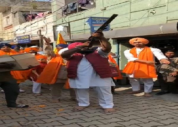 father and son arrested for firing in nagar kirtan