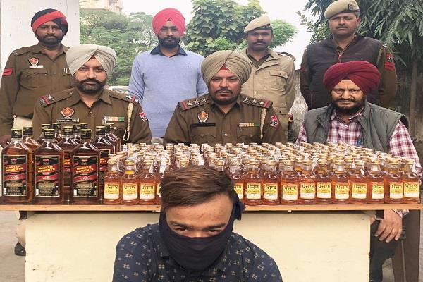 person arrested with 67 bottles of illicit liquor