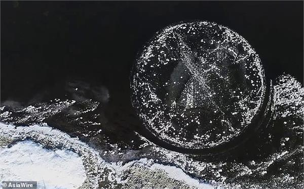 naturally formed circular ice disc spins in frozen river in china