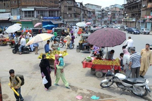 life is returning to kashmir shops open in valley
