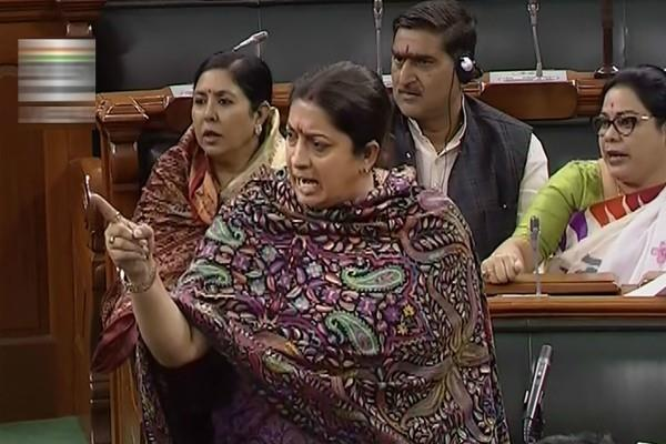 intense tussle between smriti irani and congress mps in the house