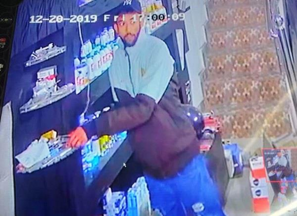 thief dabbles with mobile and money inside shop cctv imprisoned
