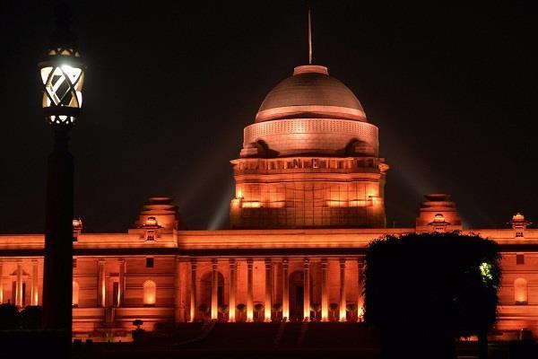 rashtrapati bhavan illuminated with orange lights for women s crime awareness