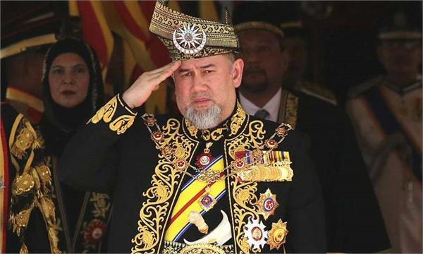in historic first malaysia s king abdicates