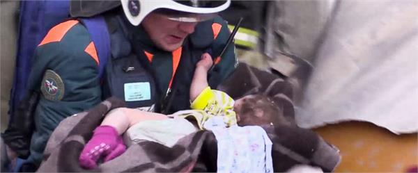 baby boy found alive in rubble of collapsed russian apartment