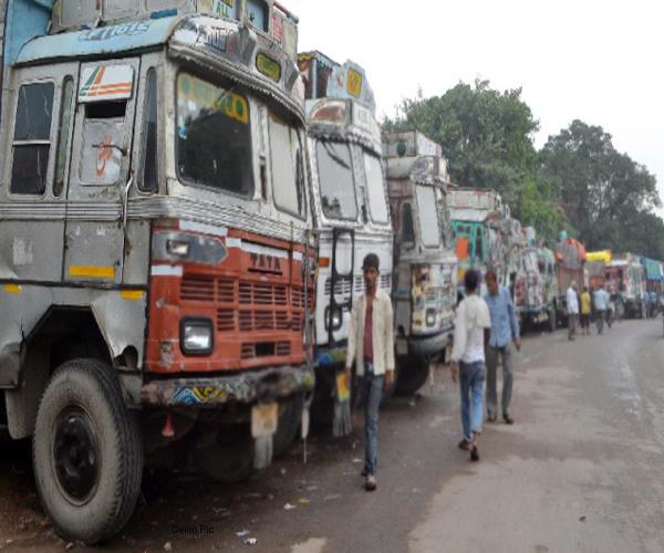holding 98 over loaded trucks involved in illegal mining