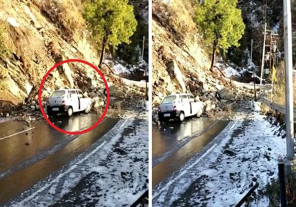 debris of hill collapsed on moving car in solan
