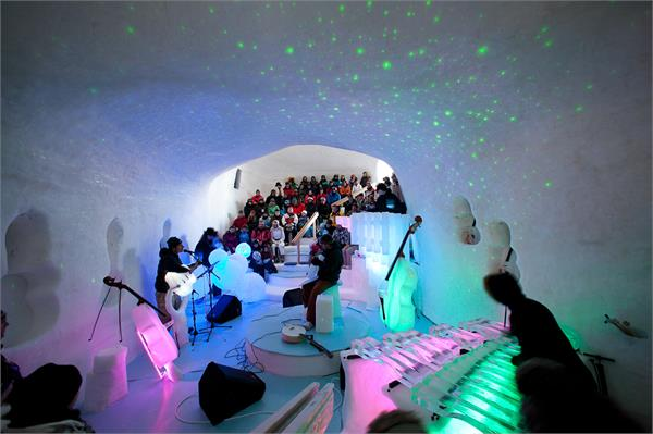 music festival in italian alps perform using instruments made from ice
