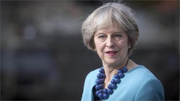 theresa may urges her mps to unite over brexit