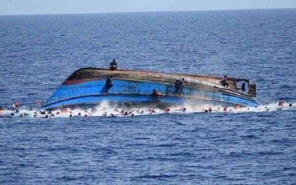 migrants boat submerged 28 people died