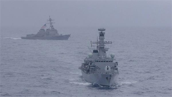 us sails warships close to disputed island chain in south china sea