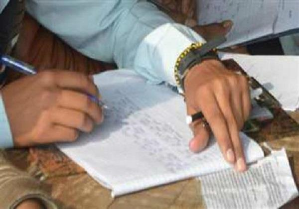 6 students holding copy in 12th board exam