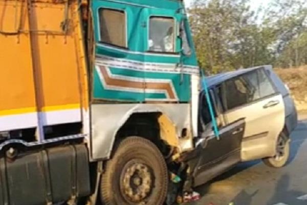 horrific collision between truck and car
