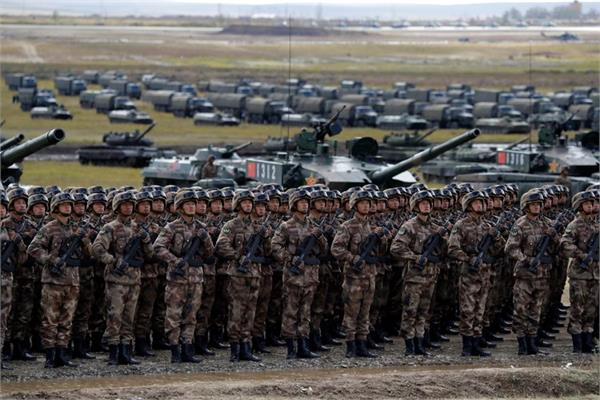 china defends heavy defence spending