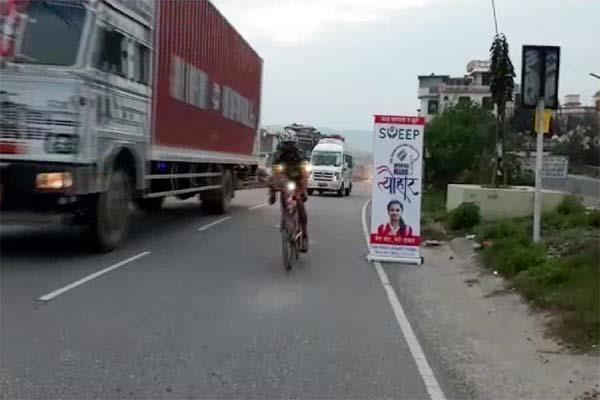 bike rider came out to make voters aware foreigners also took part
