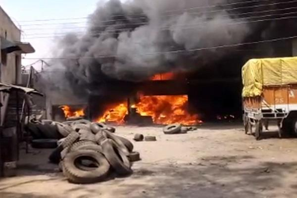 a terrible fire in the tire factory smoke smoke far and wide