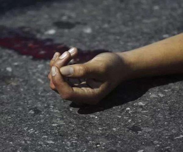 a woman strolling outside the house in prayagraj shot dead