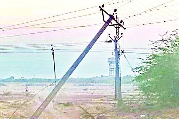 broken electric wire fallen in fields crops destroyed