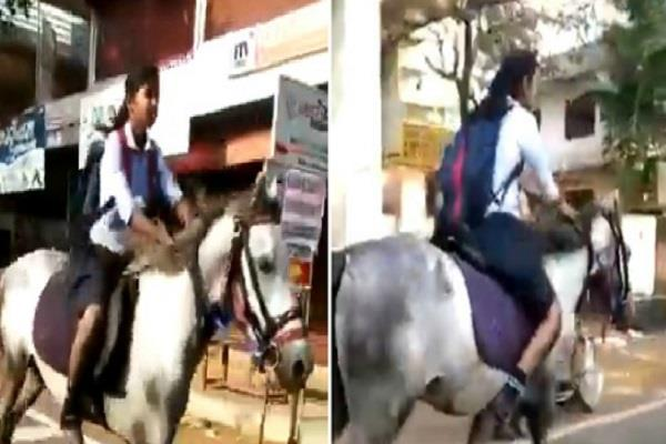 a girl riding on a horse to test the 10th