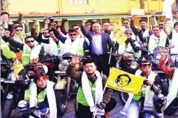 tibetan youth seeks release of panchen lama by bike rally