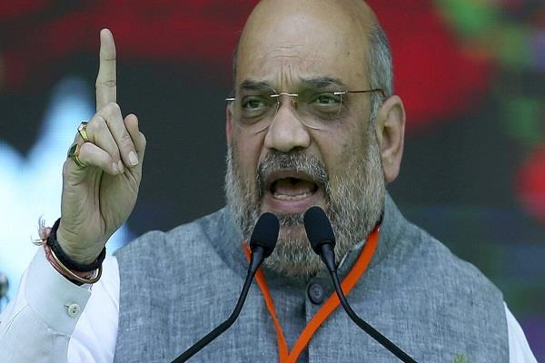 amit shah blames political conspiracy in bhima mandavi massacre