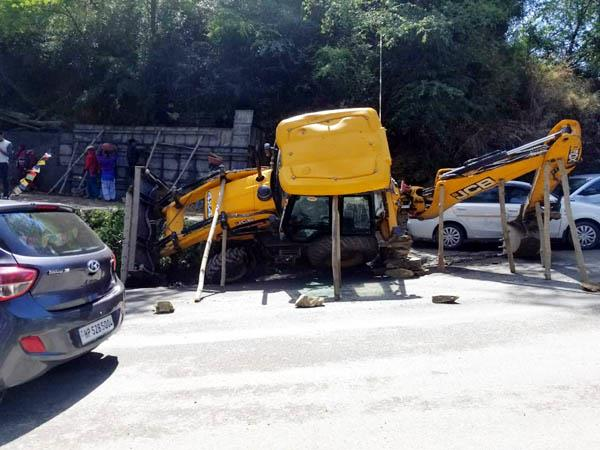 collision between jcb and tourist bus