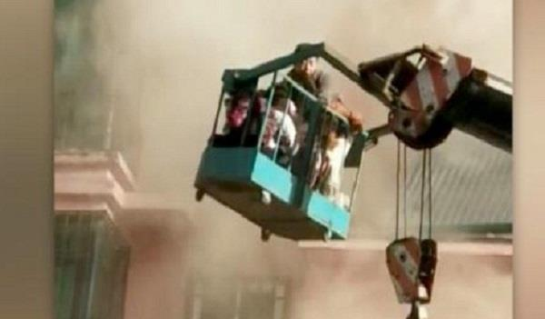 19 year old crane driver saves 14 from fire in china