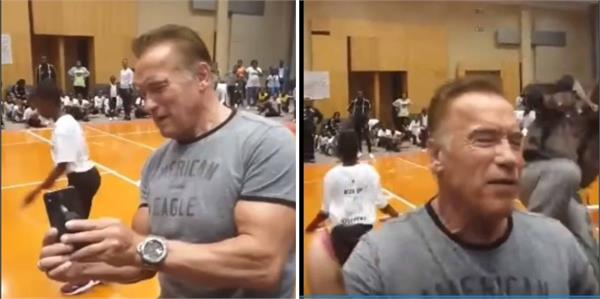 arnold schwarzenegger gets kicked from behind by a man