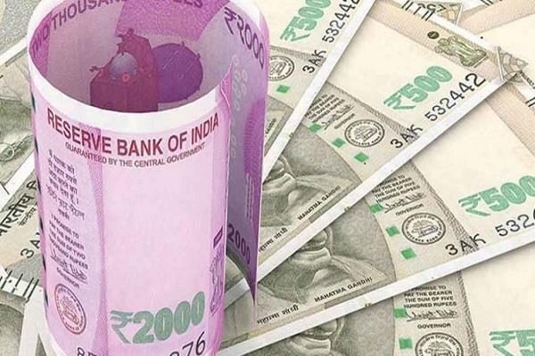 rupee trades lower at 69 87 per dollar