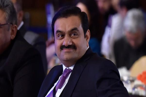 adani group shares rally up to 21as exit polls predict nda s return