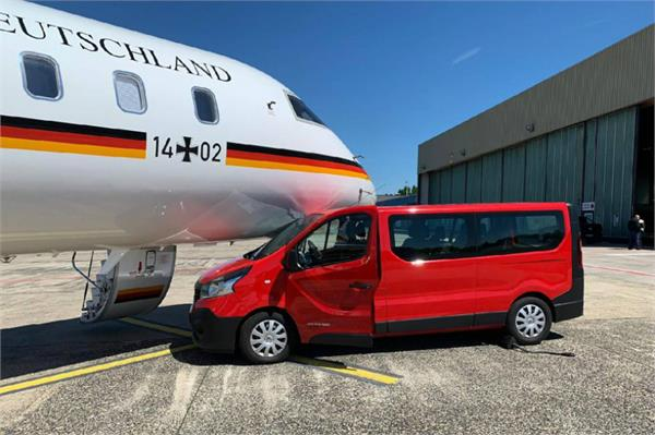 merkel s plane damaged as  over excited  fan