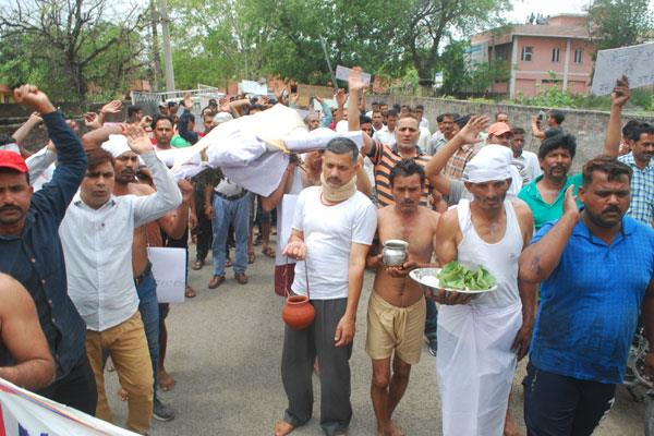 phe employees took death procession of govt