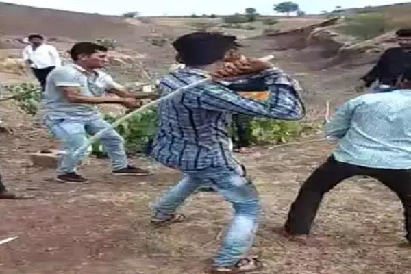the young woman was beaten by the sticks in dhar