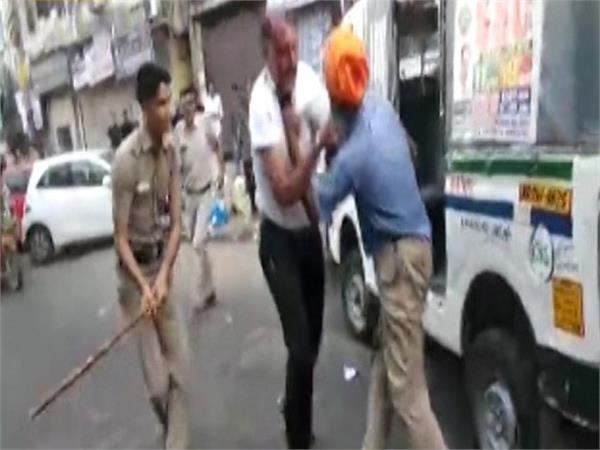 demand of dismiss of the policemen involved in beating the sikh driver