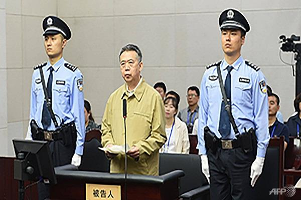 china s ex interpol chief pleads guilty to corruption