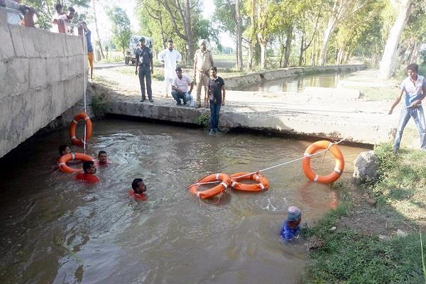 two children drowning canal 1 saved and continued search for another