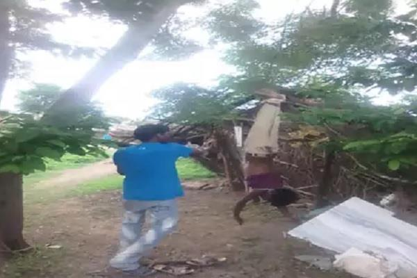 in mp beaten young man upside down from tree