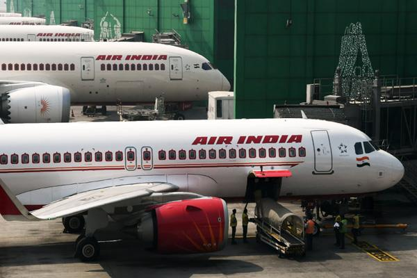 government asked air india to freeze all jobs and promotions