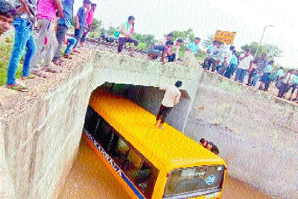 school bus hanging in railway underpass bridge