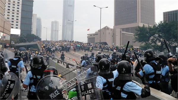protesters try to smash way into hong kong legislative council