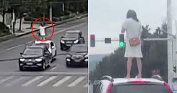 angry wife climbs on car roof after husband ignores her post a fight