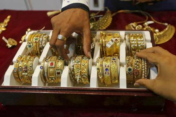 gold futures down by rs 80 silver by rs 335