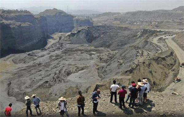 police among 18 feared killed in landslide at myanmar jade mine