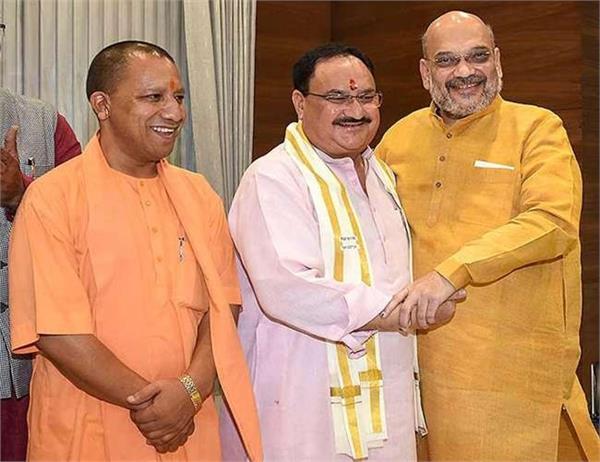up assembly by election yogi meets jp nadda and amit shah
